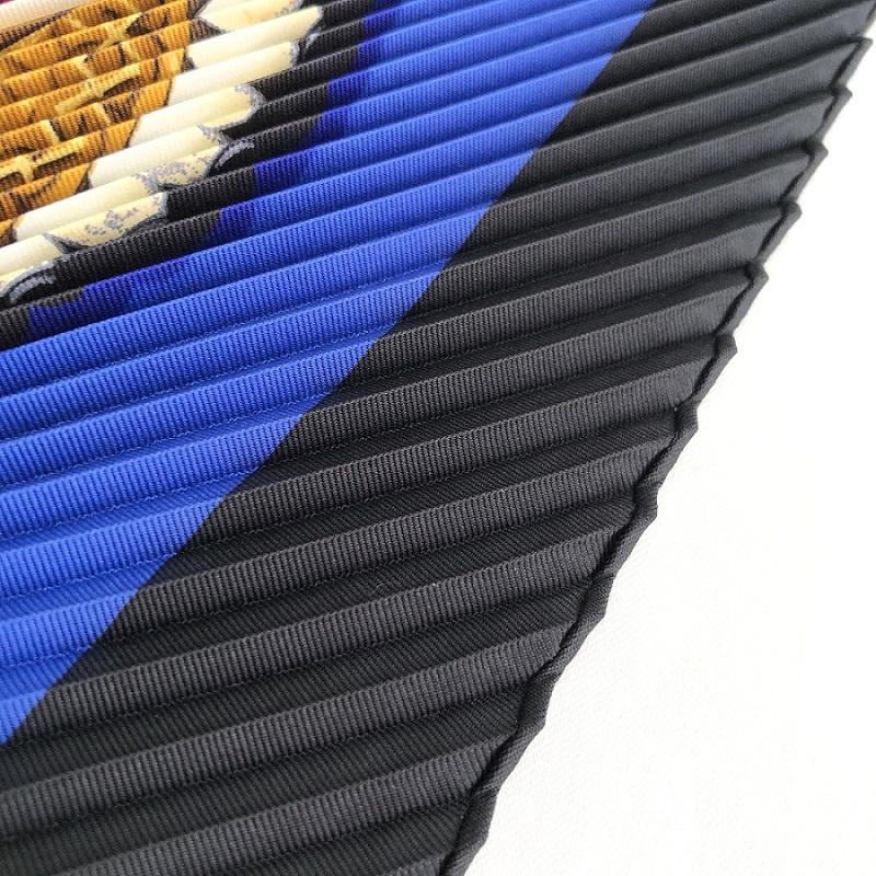 The close-up image of pleated scarf with hand-rolled edges.
