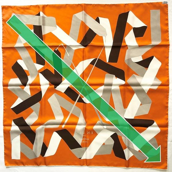 Step 1: Fold Hermes square scarf half diagonally.